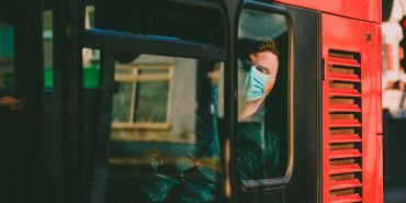 Man in a mask on a bus
