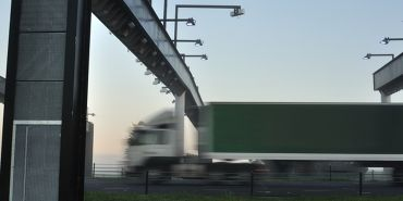 Lorry passing under toll gate