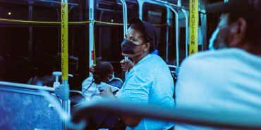 Person with face mask on a bus