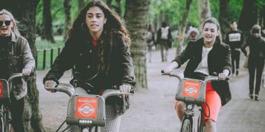 Three women on Santander bikes
